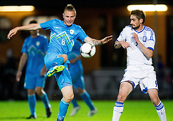 Jasmin Kurtic of Slovenia vs Lymperopoulus Nikolaos of Greece during friendly football match between national teams of Slovenia and Greece, on May 26, 2012 in Kufstein, Austria.   (Photo by Vid Ponikvar / Sportida.com)