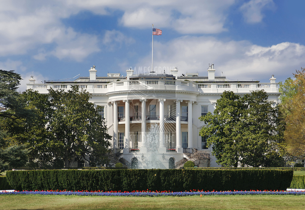 The White House in Washington DC on a partly cloudy afternoon in spring