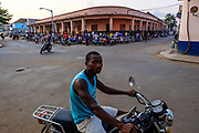 A taxiboy waits for clients for a moto ride in the streets fo São Tomé, the capital city of São Tomé e Príncipe