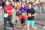 Mark (6580) dressed as Superman during The Great South Run in Southsea, Portsmouth, United Kingdom on 23 October 2016. Photo by Jon Bromley.