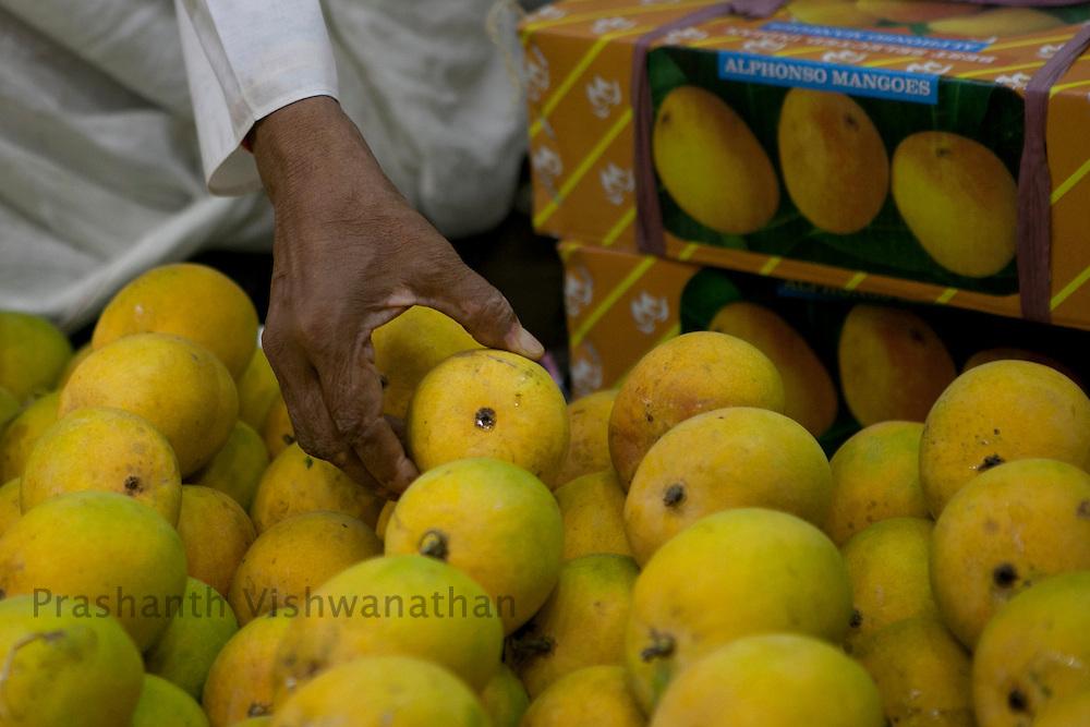 Shopkeepers sell mangoes at the crawford market in Mumbai, India, on Tuesday May 21, 2012. Photographer: Prashanth Vishwanathan