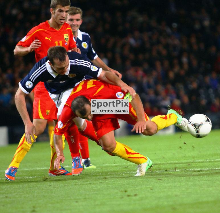 Andy Webster Scotland tangles with Goran Pandev macedonia in the .FIFA World Cup Qualifier scotland v macedonia, hampden stadium, glasgow .Kevin McGlynn(c)  | StockPix.eu.