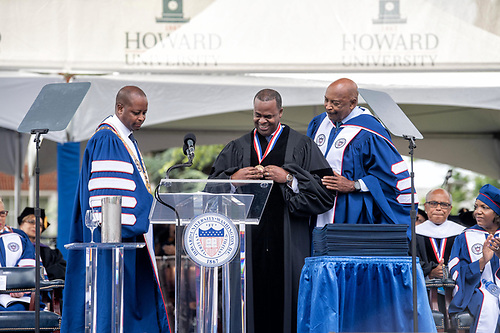 President Wayne A.I. Frederick, Kasim Reed, and Chairman of the Board Stacey Mobley onstage at Commencement.