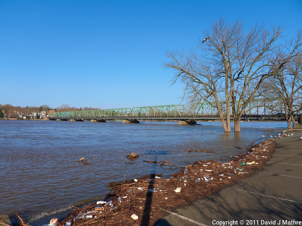 Delaware river after late winter flooding with the New Hope. PA and Lambertville, NJ bridge in the background. Image take with a Leica D-Lux 5 camera (ISO 100, 5 mm, f/4, 1/1000 sec).