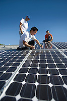 A group of men working on solar panelling