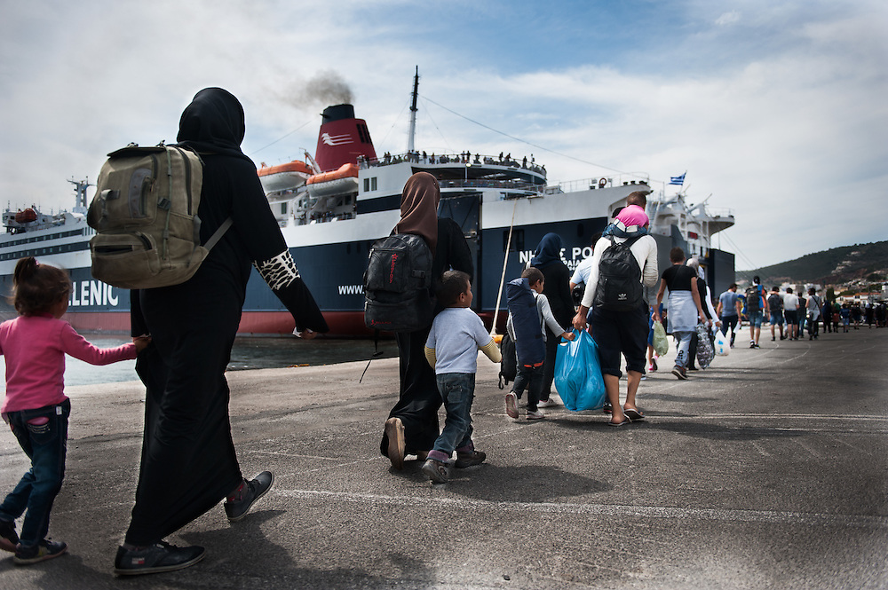 Refugees and migrants boarding a boat at the port of Mytiline that will take them to the Greek mainland.