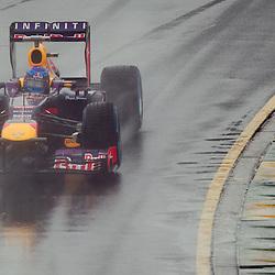 F1 Australian Grand Prix 16 March 2013 Qualifying Session 1.Qualifying Session 1.Sebastian Vettel Infinitti Red Bull Racing flys around a wet Albert Park Circuit during qualifying..(c) MILOS LEKOVIC | StockPix.eu