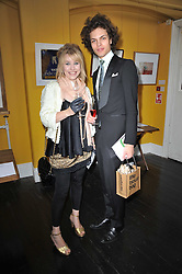 Left to right,  contributing artist LORNA MAY WADSWORTH and JOACHIM GRAM at The Special Yoga Centre's annual art auction held at the 20th Century Theatre, 291 Westbourne Grove, London W11 on 16th May 2011.