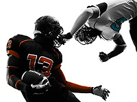 two american football players face mask in silhouette shadow on white background