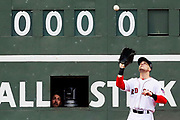 BOSTON, MA - OCTOBER 02:   A scorekeeper inside the Green Monster watches Andrew Benintendi #40 of the Boston Red Sox catche a fly ball hit by Josh Donaldson #20 of the Toronto Blue Jays as during the fifth inning at Fenway Park on October 2, 2016 in Boston, Massachusetts.  (Photo by Maddie Meyer/Getty Images)