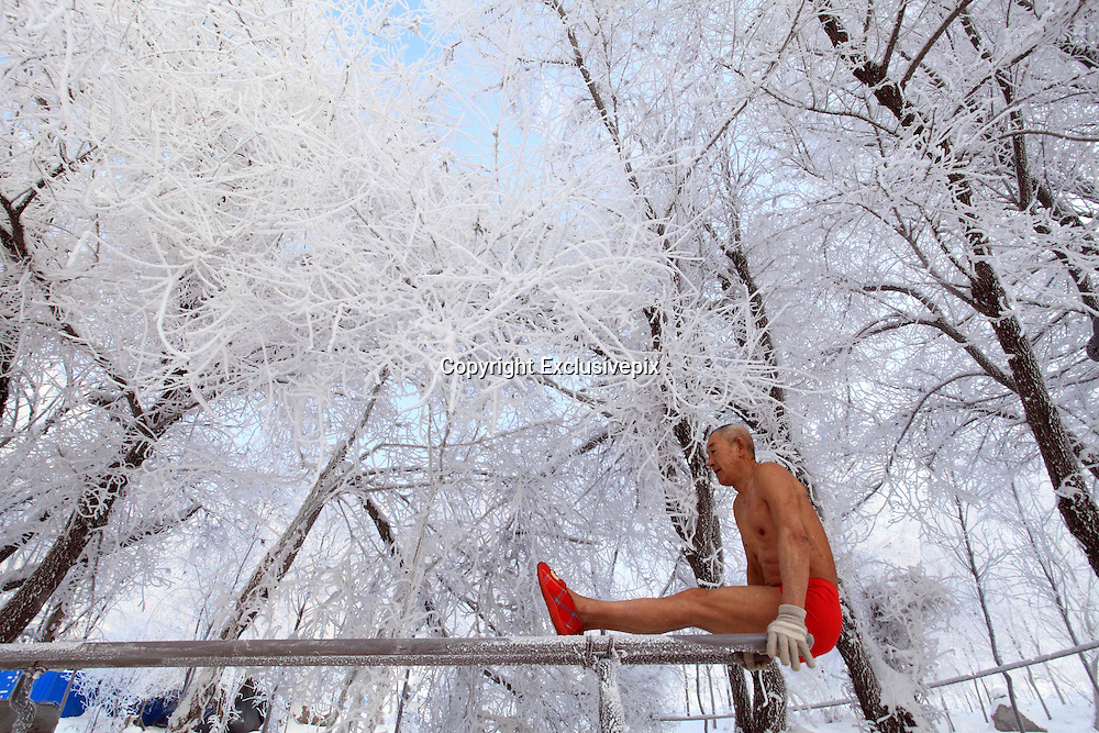JILIN, CHINA -  (China Out - Finland Out)<br /> <br /> Strong Old Man In Jilin<br /> 77-year-old man Gao Yinyu wearing underwear does morning exercises on the banks of Songhuajiang River as the temperature reaches 25 degrees below zero in Jilin, Jiling Province of China. Gao said that he does morning exercises all the year round after retirement, never missed a day. Chinese male employees usually retire at the age of 60. <br /> ©Exclusivepix