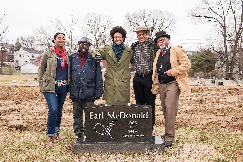 Vania Marie Kinard, left, Writer Michael L. Jones, Brian Farrow, Dom Flemons and Jonathan Finn Formica pose beside Earl McDonald's grave. <br /> Dom Flemons, a founding member of the Piedmont string-band ensemble the Carolina Chocolate Drops, visits Louisville Cemetery, burial site of Earl McDonald and Sara Martin Friday, March 4, 2016 in Louisville, Ky. (Photo by Brian Bohannon)