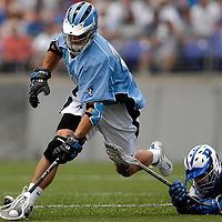 28 May 2007:  Johns Hopkins midfielder Stephen Peyser (12) wins a 1st quarter face-off against Duke University mid fielder Terrence Molinari (30) in the NCAA Division I Lacrosse Championship game.  The Johns Hopkins Blue Jays defeated the Duke Blue Devils 12-11 to win the NCAA Division I Lacrosse championship at M&T Bank Stadium in Baltimore, Md. .