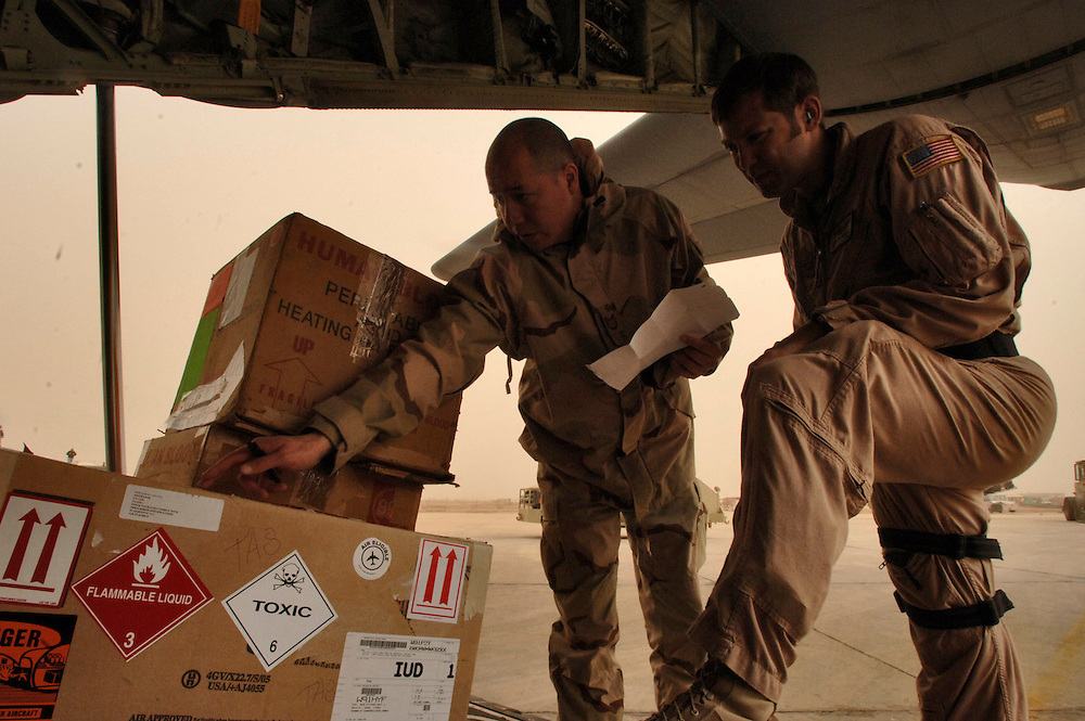 SOUTHWEST ASIA (AFPN) ? Amidst wind blown sand, Senior Airman Marc Garnsey (right) and Staff Sgt. Thedore Hogan, inventory boxes of human blood and other critical cargo that was delivered aboard a C-130J Hercules cargo aircraft of the 746th Expeditionary Airlift Squadron, Southwest Asia.  Senior Airman Garnsey is assigned to the 115th Airlift Squadron, California Air National Guard, Channel Island, Ca. This aircraft is the latest addition to the C-130 fleet. It incorporates state-of-the-art technology to reduce manpower requirements; lower operating costs, and provides life-cycle cost savings over earlier C-130 models. Its distinctive 6-bladed composite propeller coupled to a Rolls-Royce AE2100D3 turboprop engine brings substantial performance improvements. The four engines, each rated at 4.700 horsepower enable the aircraft to fly 5,000 feet higher (28,000 feet) and 50 mph faster (417 mph) than the preceding H-model.  (U.S. Air Force photo by Master Sgt. Lance Cheung)<br />