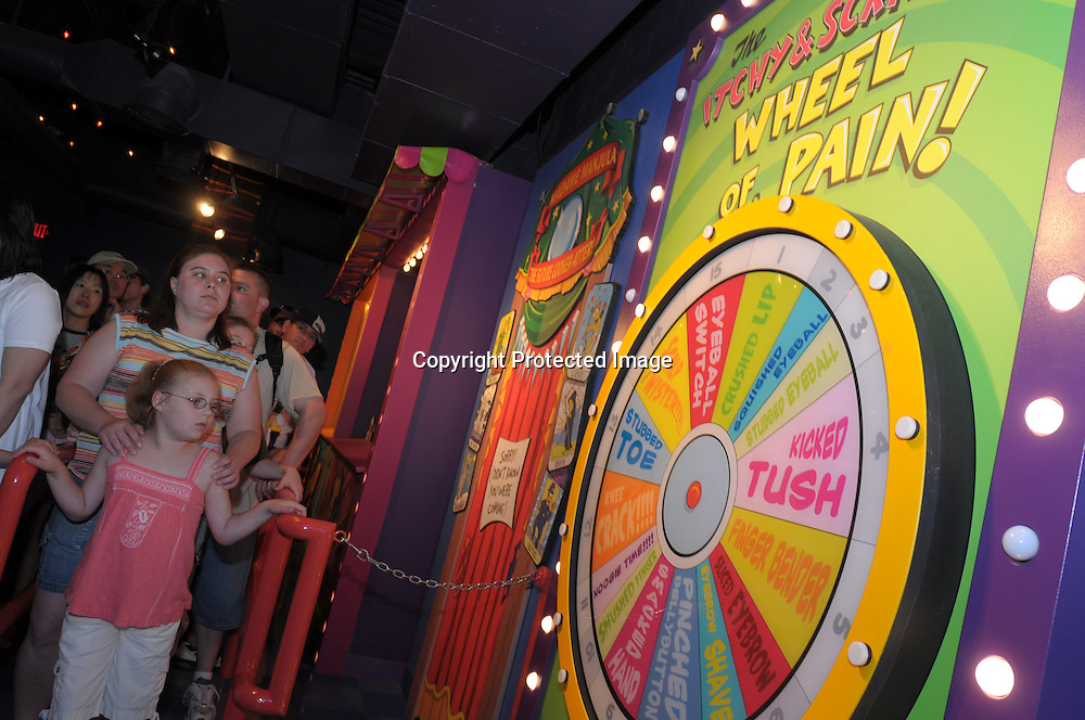 Tourists stand in the gueue to the newly-opened The Simpson's Ride at Universal Orlando in Orlando, Fla., Tuesday, April 29, 2008. (Photo by Phelan M. Ebenhack)