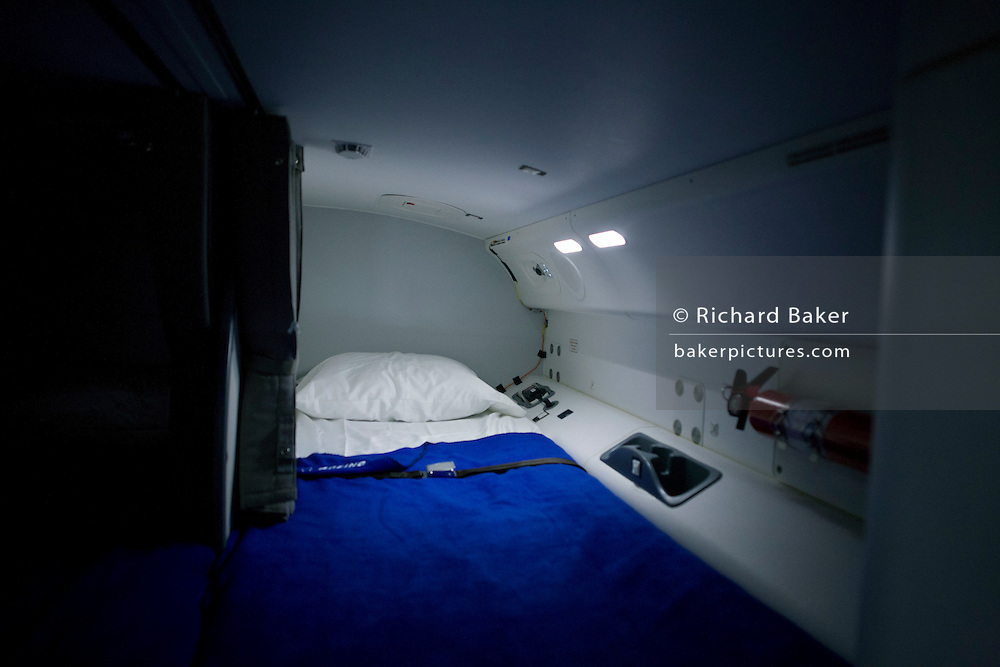 Flight crew rest bedding on the Boeing-manufactured 787 Dreamliner (N787BX) at the Farnborough Airshow. On its first flight outside of the US during its testing programme, the newest airliner in the Boeing aviation family, has arrived at the air show for a few days of exhibitions to the aerospace-buying community and the trade press. Later the public will have the chance to see this jet up close too. The Boeing 787 Dreamliner is a long range, mid-sized, wide-body, twin-engine  jet airliner developed by Boeing Commercial Airplanes. It seats 210 to 330 passengers, depending on variant. Boeing states that it is the company's most fuel-efficient airliner and the world's first major airliner to use composite materials for most of its construction