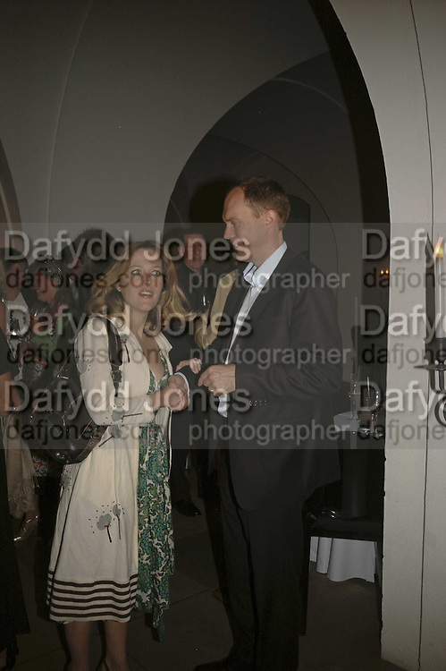 Gillian Anderson and harry Blain, VIP opening of Bill Viola exhibition Love/Death: The Tristan project. Haunch of Venison, St Olave's College, Tooley St. London and Dinner afterwards at Banqueting House. Whitehall. 19 June 2006. ONE TIME USE ONLY - DO NOT ARCHIVE  © Copyright Photograph by Dafydd Jones 66 Stockwell Park Rd. London SW9 0DA Tel 020 7733 0108 www.dafjones.com