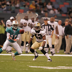 2008 August 28: Cornerback, Jason David (42) of the New Orleans Saints closes in on Miami Dolphins receiver Anthony Armstrong (11) during a preseason game at the Louisiana Superdome in New Orleans, LA.
