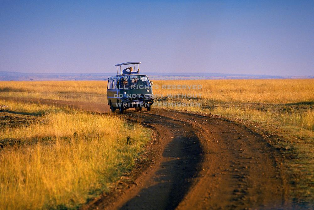 Image of safari explorers viewing wildlife at the Masai Mara National Reserve in Kenya, Africa