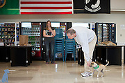 A handler working with Sparky while Ms. E. watches in the background.  Pet photos by Michael Kloth.