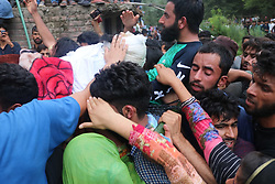 July 26, 2018 - Anantnag, Jammu And Kashmir, India - Kashmiri people carrying the body slain Armed Rebel Bilal Ahmed Dar at Khudwani area of South Kashmirs Kulgam district. Bilal was killed with his associate Aadil Hussain Bhat in south Kashmir's Anantnag district on 25,July,2018 (Credit Image: © Yawar Hamid/Pacific Press via ZUMA Wire)