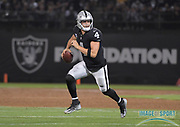 Sep 10, 2018; Oakland, CA, USA;  Oakland Raiders quarterback Derek Carr (4) prepares to throw the ball against the Los Angeles Rams at the Oakland-Alameda County Coliseum. The Rams defeated the Raiders 33-13.