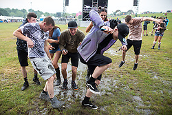 © Licensed to London News Pictures . 11/06/2016 . Manchester , UK . Revellers dancing in the mud at the Parklife music festival at Heaton Park in Manchester . Photo credit : Joel Goodman/LNP