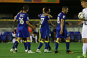 AFC Wimbledon striker Andy Barcham (17) scores a goal 1-0 scores and celebrates with team during the EFL Trophy match between AFC Wimbledon and U23 Swansea City at the Cherry Red Records Stadium, Kingston, England on 30 August 2016. Photo by Stuart Butcher.