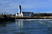 Pretty church and frozen river at Selfoss, south-west Iceland