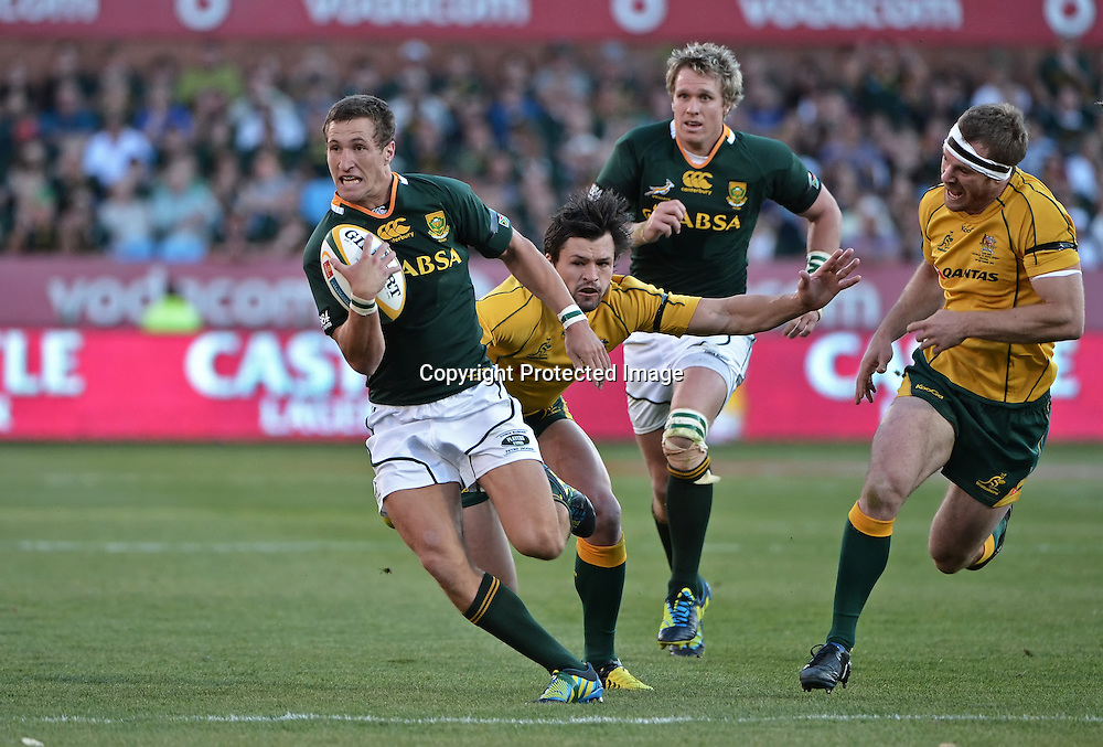 CASTLE RUGBY CHAMPIONSHIP 2012, LOFTUS VERSFELD STADIUM in PRETORIA, 29 September 2012. Johan Goosen of the Springboks gets across the advantage line with Adam Ashley-Cooper of the Wallabies missing the tackle during the CASTLE RUGBY CHAMPIONSHIP match between South Africa and Australia at Loftus Versfeld Stadium in Pretoria, South Africa on 29 September 2012.<br /> Photographer : Anton de Villiers / SASPA