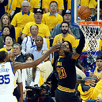 12 June 2017: Cleveland Cavaliers forward LeBron James (23) goes for the layup past Golden State Warriors forward Kevin Durant (35) during the Golden State Warriors 129-120 victory over the Cleveland Cavaliers, in game 5 of the 2017 NBA Finals, at the Oracle Arena, Oakland, California, USA.
