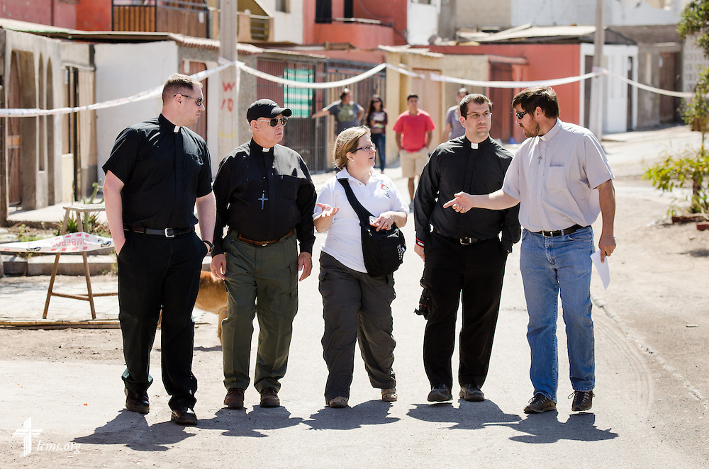 Members of the LCMS Disaster Response team, including (L-R), the Rev. Michael Meyer, manager, the Rev. Glenn Merritt, outgoing director, Deaconess Pam Nielsen of LCMS Communications, and the Rev. Ross Johnson, current director, walk with the Rev. Cristian E. Rautenberg, president of the Confessional Lutheran Church of Chile, on Wednesday, April 23, 2014, in Alto Hospicio, Chile. The city was damaged by a magnitude 8.2 earthquake on April 1, 2014, that struck approximately 95km northwest of Iquique. The earthquake condemned several thousand homes and severely damaged more than 10,000 others. LCMS Communications/Erik M. Lunsford