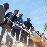 Zuni Governor Val Panteah, left, State Director for USDA Rural Development Terry Brunner and other officials with Zuni Housing Authority and new homeowners break ground on a block of new homes in the Black Rock area of Zuni, Wednesday.