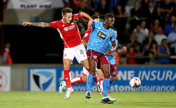 Josh Brownhill of Bristol City tackles Hakeeb Adelakun of Scunthorpe United - Mandatory by-line: Robbie Stephenson/JMP - 23/08/2016 - FOOTBALL - Glanford Park - Scunthorpe, England - Scunthorpe United v Bristol City - EFL Cup second round