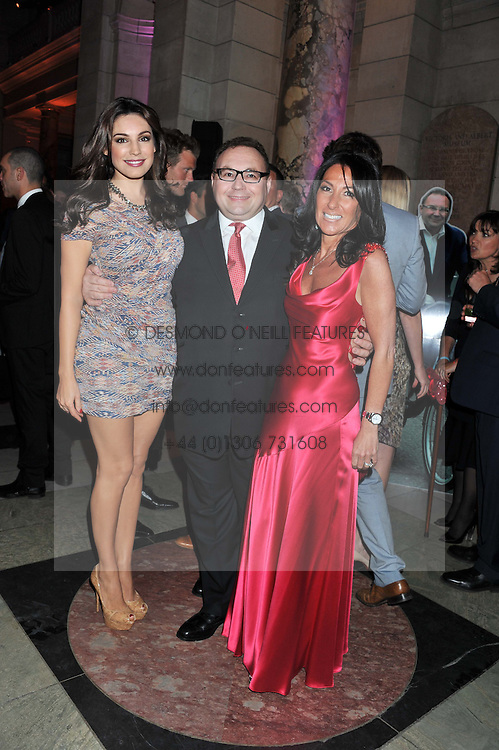 Left to right, KELLY BROOK, JONATHAN SHALIT and KATRINA SHALIT at the 50th birthday party for Jonathan Shalit held at the V&A Museum, London on 17th April 2012.