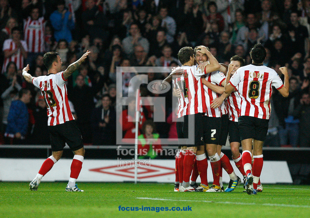 Picture by Daniel Chesterton/Focus Images Ltd. 07966 018899.19/11/11.Rickie Lambert of Southampton celebrates with teammates after scoring their second goal from the penalty spot during the Npower Championship match at St Marys Stadium, Southampton.