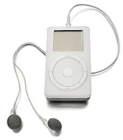 an original apple ipod with earbud headphones photographed on a white background