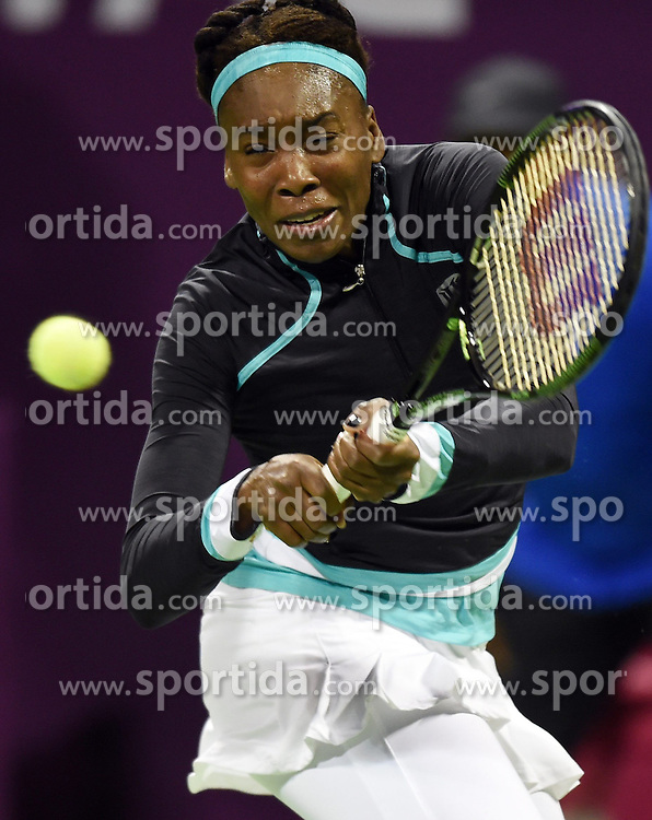Venus Williams of the United States returns the ball during the first round match against Casey Dellacqua of Australia in the WTA Qatar Open tennis tournament in Doha, Qatar, Feb. 23, 2015. Venus Williams won 2-1. EXPA Pictures &copy; 2015, PhotoCredit: EXPA/ Photoshot/ Chen Shaojin<br /> <br /> *****ATTENTION - for AUT, SLO, CRO, SRB, BIH, MAZ only*****