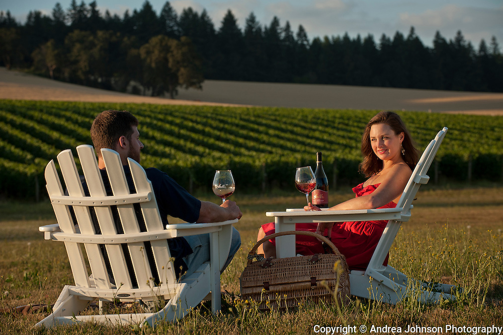 Couple enjoying wine tasting at Stoller Vineyards, Dundee Hills, Willamette Valley, Oregon.
