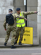 © Licensed to London News Pictures. 18/07/2012. Westminster, UK. Soldiers at Admiralty Arch. Soldiers, police and security contractors perform security checks around Olympic sites in Westminster today, 18th July 2012. Photo credit : Stephen Simpson/LNP