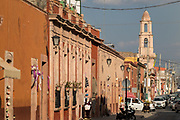 View down Guanajuato Street toward the El Calvario church in Dolores Hidalgo, Guanajuato, Mexico. Miguel Hildago was a parish priest who issued the now world famous Grito - a call to arms for Mexican independence from Spain.