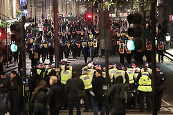© Licensed to London News Pictures . 05/11/2016 . London , UK . Police on Whitehall . Supporters of Anonymous , many wearing Guy Fawkes masks , attend the Million Mask March bonfire night demonstration , in central London . Photo credit : Joel Goodman/LNP