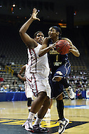 24 MARCH 2009: Georgia Tech guard Jacqua Williams (1) tries to shoot around Oklahoma center Courtney Paris (3) during an NCAA Women's Tournament basketball game Tuesday, March 24, 2009, at Carver-Hawkeye Arena in Iowa City, Iowa. Oklahoma defeated Georgia Tech 69-50.