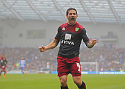 Norwich City Bradley Johnson celebrates his opening goal  during the Sky Bet Championship match between Brighton and Hove Albion and Norwich City at the American Express Community Stadium, Brighton and Hove, England on 3 April 2015. Photo by Phil Duncan.