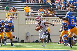 September 24, 2011; San Jose, CA, USA;  New Mexico State Aggies quarterback Matt Christian (2) rushes for a touchdown against the San Jose State Spartans during the third quarter at Spartan Stadium. San Jose State defeated New Mexico State 34-24.