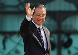 © licensed to London News Pictures. KUALA LUMPUR 28/04/11.Chinese Premier Wen Jiabao waves his hand and smiles at the prime minister's office in Putrajaya outside Kuala Lumpur on April 28, 2011.Wen began a two-day visit to Malaysia to reaffirm relations and boost economic ties between the two countries. Please see special instructions for usage rates. Photo credit should read Mohd Rasfan/LNP