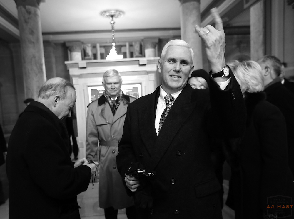 Indiana Gov. Mitch Daniels with Gov. Elect Mike Pence at the Statehouse before his inauguration in Indianapolis, Monday January 14,2013. (Photo by AJ Mast)