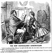 Darwinism: everyday proof of man's origins. Cartoon from 'Punch' (London, 1861). Wood engraving.