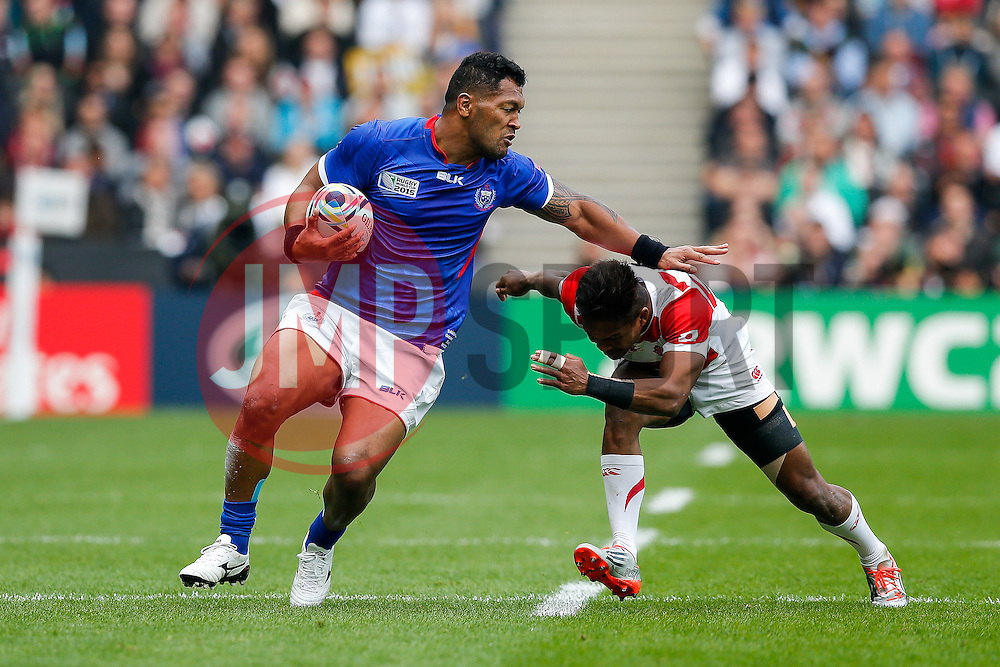 Samoa Inside Centre Johnny Leota is tackled by Japan Winger Kotaro Matsushima - Mandatory byline: Rogan Thomson/JMP - 07966 386802 - 03/10/2015 - RUGBY UNION - Stadium:mk - Milton Keynes, England - Samoa v Japan - Rugby World Cup 2015 Pool B.