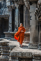 Angkor, Cambodia - January 1, 2014: buddhist monk walking in Angkor Wat temple Cambodia on january 1st, 2014